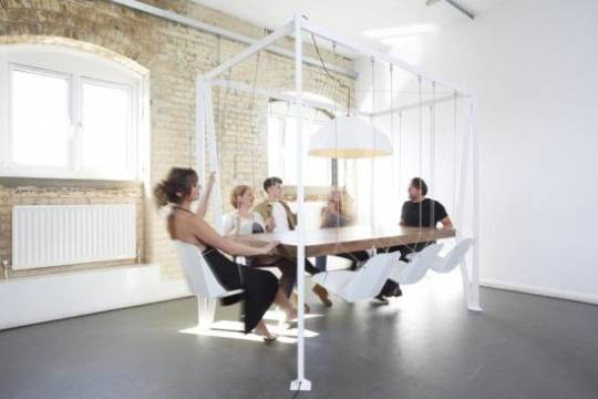 The bespoke Swing Table by Duffy London revolutionizes the boring dining table