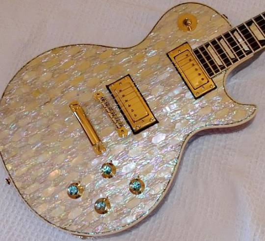 Gibson Les Paul Deluxe guitar with 24-carat gold and mother of pearl lining