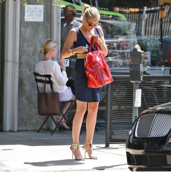 Sharon Stone seems to be in love with the elegant, designer handbag from Yves Saint Laurent
