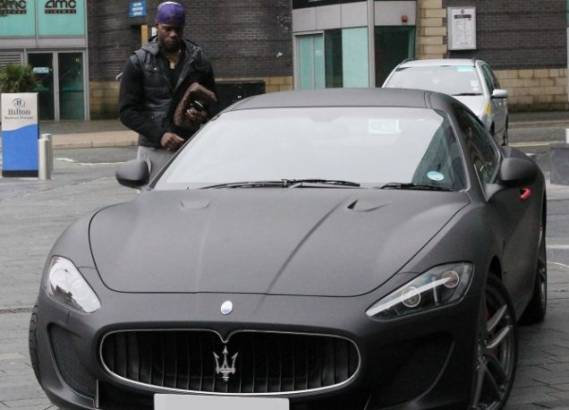 Mario Balotelli with his Maserati GT