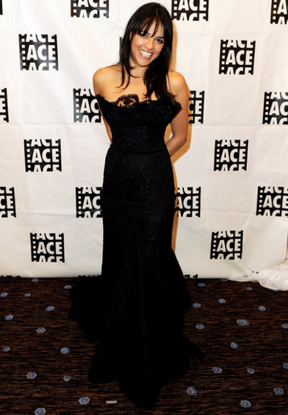 The actress has donned this designer black strapless gown in a red carpet event.