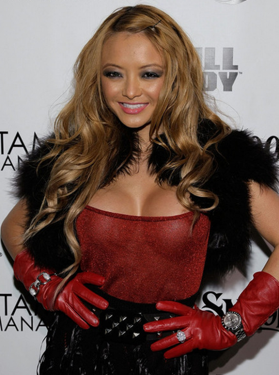 Pint-sized media personality Tila Tequila really knows how to make an entrance and she was seen sporting a trendy Goat Fur Cape from Marni's Fall/Winter 2010 Ready to Wear collection.