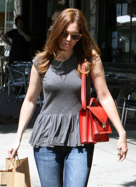 The actress was photographed carrying her '$1,595' satchel while shopping.