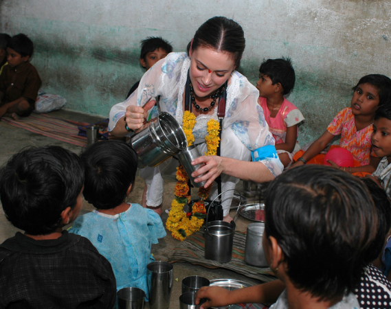 Milano has been a UNICEF goodwill ambassador since 2003. In this image she is in India for UNICEF campaign