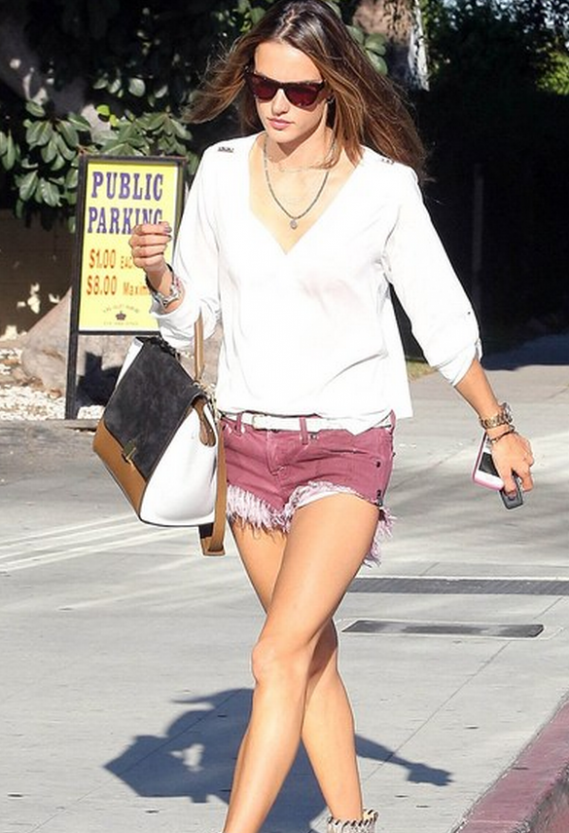 Walking out of the public parking area, supermodel Alessandra Ambrosio chose to carry all her stuff in a large, white and brown Trapeze Bag from brand Celine.