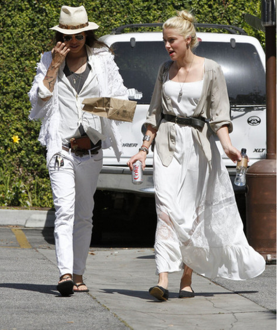 Shopping at Fred Segal in West Hollywood and flaunting her chic style, Amber Heard looked California-cool in the lace-panel maxi dress from Topshop.