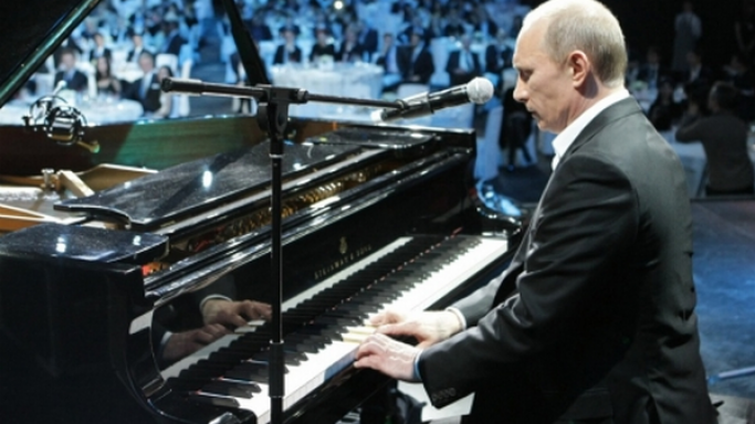 Vladimir Putin playing guitar