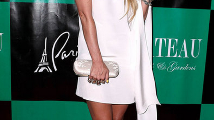 Jenna flaunted her high-end Versace Resort 2011 Lace-Up sandals in a high profile event.