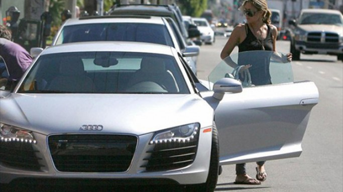 Conrad purchased an ice silver colored Audi R8 about four years back.