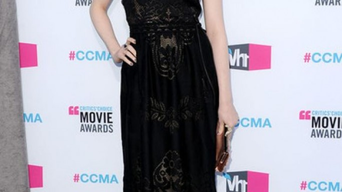 The beautiful and ethnic strapless lace gown (black in color) was worn by Evan Rachel Wood while attending the 17th Annual Critics' Movie Choice Awards, held on January 17th, 2012.