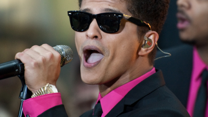 Bruno likes to wear classic American pieces like the Men's Rolex Day Date President Wristwatch.